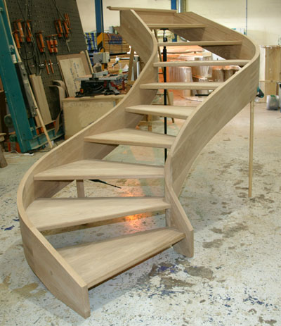 About stairs uk timber stair manufacturers wooden stairs for Curved stair case